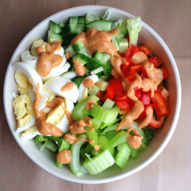 Romaine lettuce, hardboiled egg, cucumber, red bell pepper, celery, and peanut dressing. Not pictured: pearl couscous at the bottom.